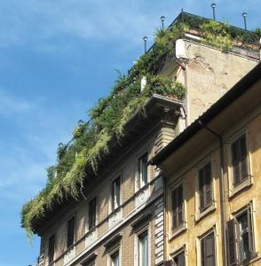 Aprender a relajarse. Imagen de terraza edificio con jardín